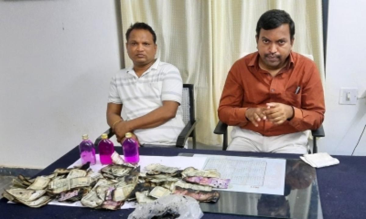 Telangana Man Burns Bribe Money To Avoid Being Caught-TeluguStop.com