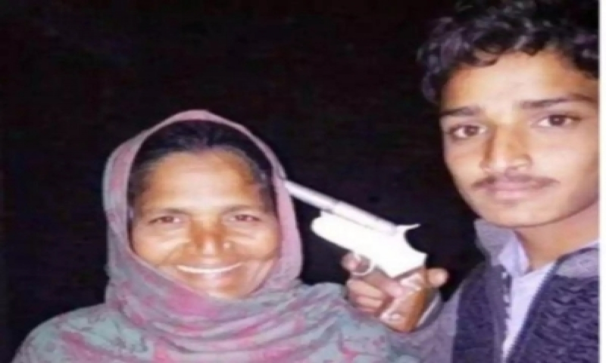 TeluguStop.com - Up: Youth Poses With Gun At His Mother's Head, Arrested