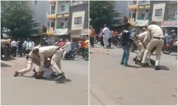 Indore Police Beaten A Person For Not Wearing A Mask-మాస్కు ధరించలేదని దారుణంగా ప్రవర్తించిన పోలీసులు.. ఇంత ఘోరమా.. -Breaking/Featured News Slide-Telugu Tollywood Photo Image-TeluguStop.com