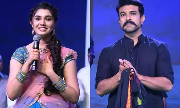 Krithi Shetty Says Shee Is A Huge Fan Of Tollywood Star Hero Ram Charan-TeluguStop.com