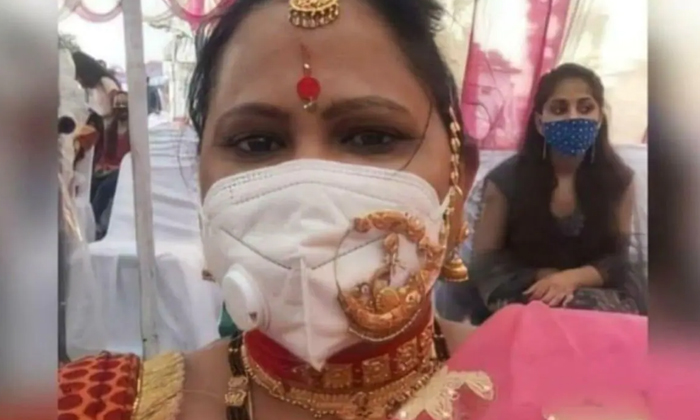Viral The Woman Wearing A Nose Splint Is A Wit Adurs-TeluguStop.com
