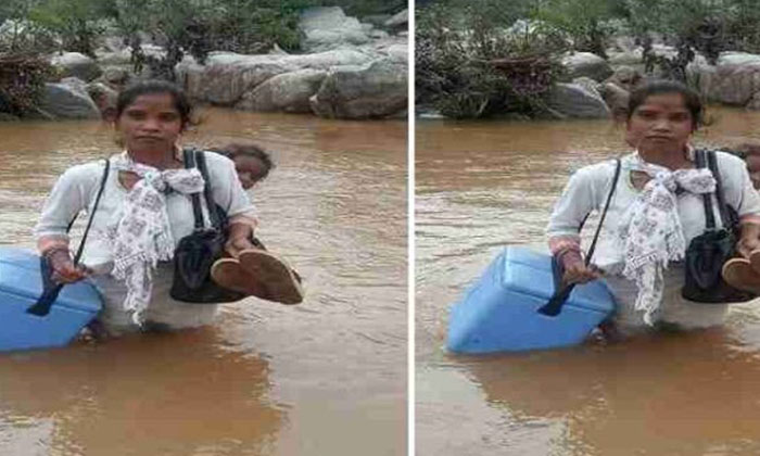 Medicine Can In One Hand A Woman Carrying A Baby On Her Back Crossing The River Health Woman Assistant-TeluguStop.com