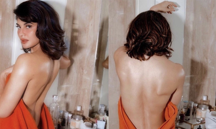 Saho Movie Fame Jacqelin Fernandez Looks Stunning Top Less Attire-TeluguStop.com