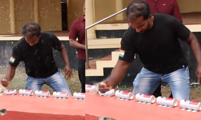 See How One Can Break A Can With One Hand-TeluguStop.com
