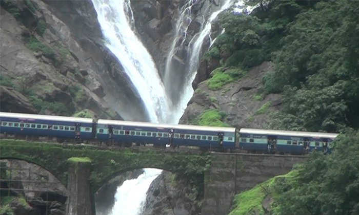 The Train Speeding Through The Waterfalls Seen Adurs-TeluguStop.com