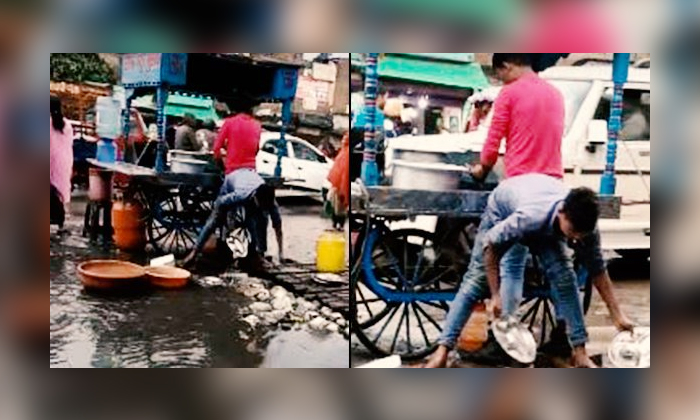 Guy Washing Plates In Dirty Water-TeluguStop.com