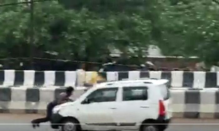 Viral Video Kadandoy Film Shooting A Man Going With Lightning Speed On The Car Bonnet-TeluguStop.com