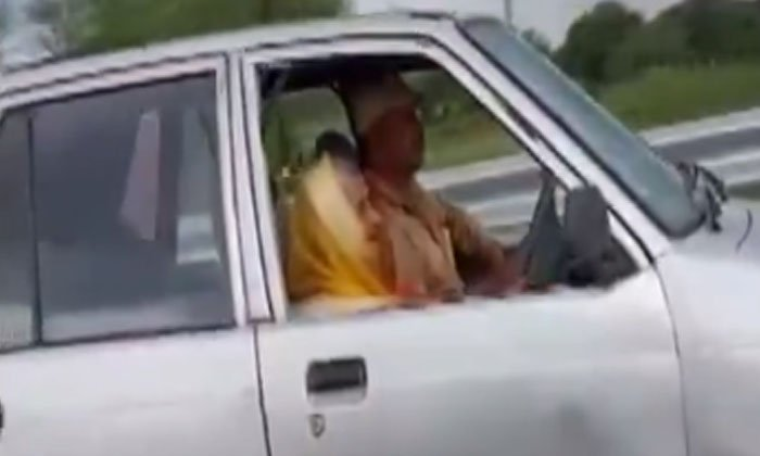 Grandmother Driving A Car In Her 90s-TeluguStop.com