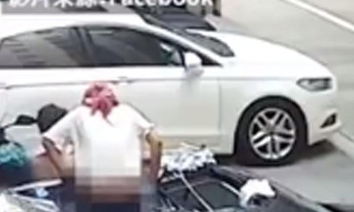 Semi Nude Woman Fell On Car From Balcony-TeluguStop.com